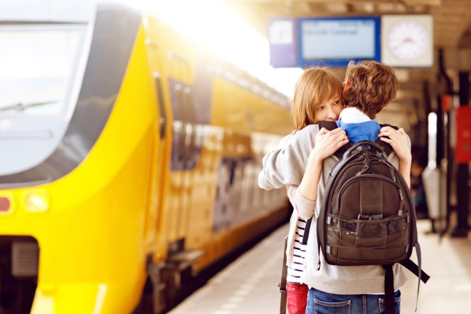 young adults hugging at the railway station